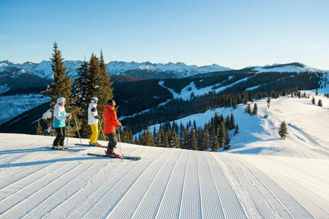 Group skiing groomed terrain in Vail, Colorado.